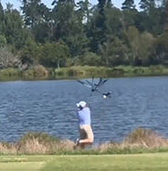 OnlineGolf News: Golfer throws clubs in lake during poor showing