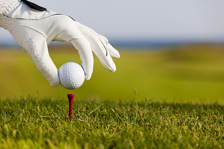 A golf ball on the tee from the Olympics training